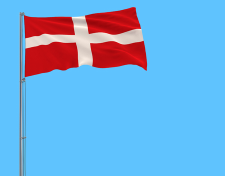 Flag of Sovereign Military Order of Malta on the flagpole fluttering in the wind on a pure blue background