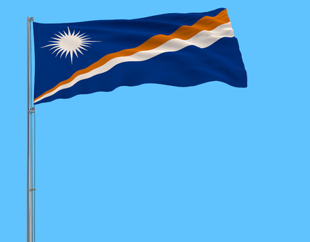 Flag of Marshall Islands on the flagpole fluttering in the wind on a pure blue background, 3d rendering