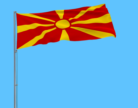 Isolate flag of Macedonia on a flagpole fluttering in the wind on a blue background, 3d rendering