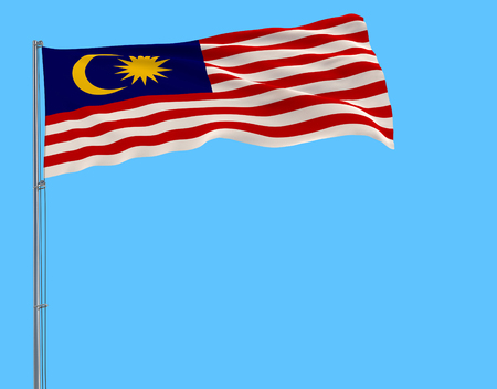 Isolate flag of Malaysia on a flagpole fluttering in the wind on a blue background, 3d rendering