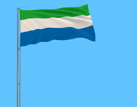 Flag of Sierra Leone on the flagpole fluttering in the wind on a pure blue background, 3d rendering