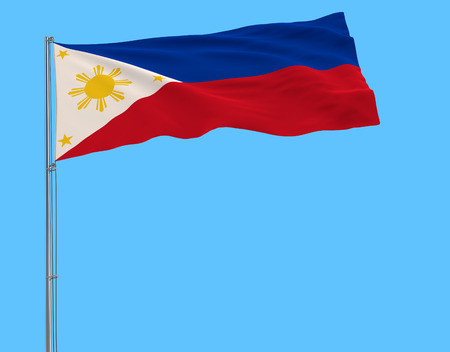 Flag of Philippines in peacetime on the flagpole fluttering in the wind on pure blue background