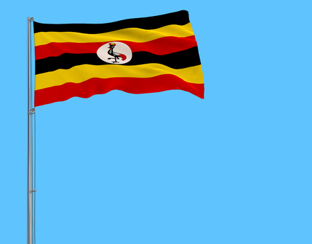 Isolate flag of Uganda on a flagpole fluttering in the wind on a blue background, 3d rendering