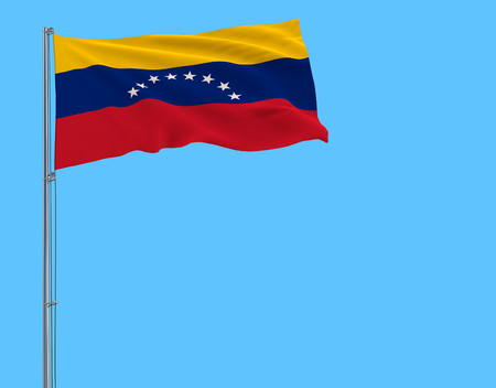 Flag of Venezuela on the flagpole fluttering in the wind on pure blue background, 3d rendering
