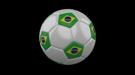 Soccer ball with the flag of Brazil colors on black background, 3d rendering 스톡 콘텐츠