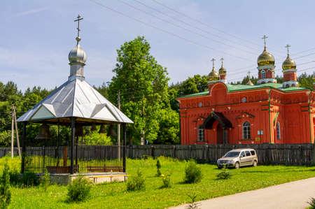 The belfry and the Makaryevskaya church on the territory of the Holy Vvedensky Makaryevsky Zhabyn Monastery, summer