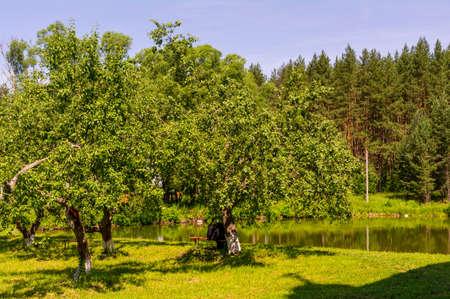 Pond on the territory of the Holy Vvedensky Makaryevsky Zhabyn Monastery, summer. Archivio Fotografico