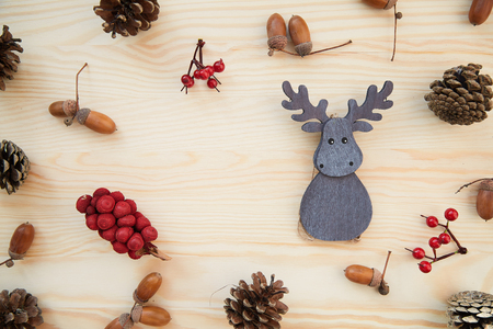 acorn tree: Christmas frame: cones, cinnamon, berries, acorn on the wood table