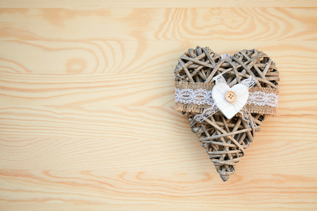 Christmas frame: dry heart on the wood table