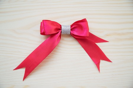 Red ribbon on a wood background with clipping paths.