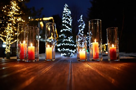 Beautiful candles with lights on wooden floor Stock fotó