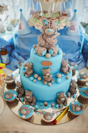 Delicious birthday cake on table on blue background Stock fotó