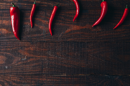 chili peppers on a wooden background