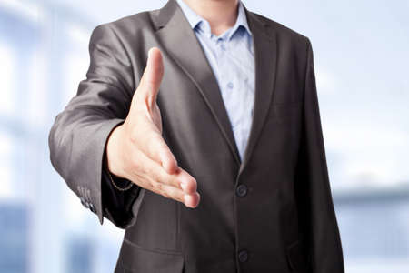 businessman extending hand to shake isolated on white background  Stock Photo