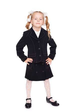 nice little girl in a school uniform photo