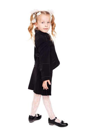 hair bow: nice little girl in a school uniform
