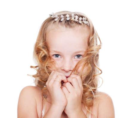Portrait of shy pretty little girl photo