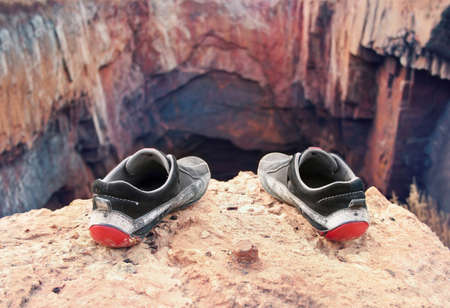 brink: Shabby old shoes of the suicide on the brink of a precipice
