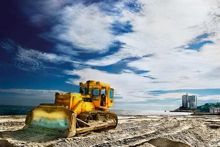 Tractor on a sandy beach near the sea Stock Photo - 10332029