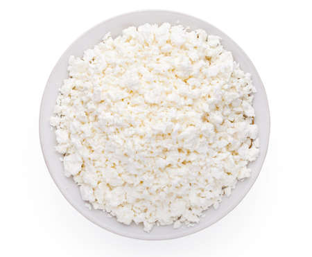 Cottage cheese in plate isolated on white background  Stock Photo