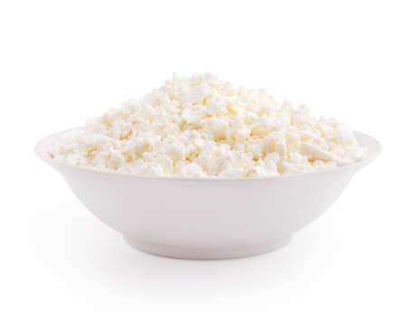 queso blanco: Queso cottage en la placa sobre fondo blanco Foto de archivo