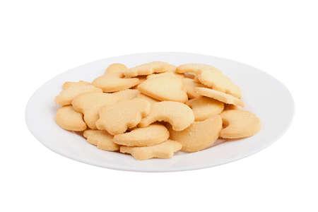 galletas de navidad: galletas con formas diferentes de la placa sobre fondo blanco