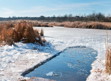 water hole: Winter ice-hole for swimming in cold water Stock Photo