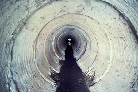 Industrial tunnel. Cement Sewer Pipe. Underground waste system photo