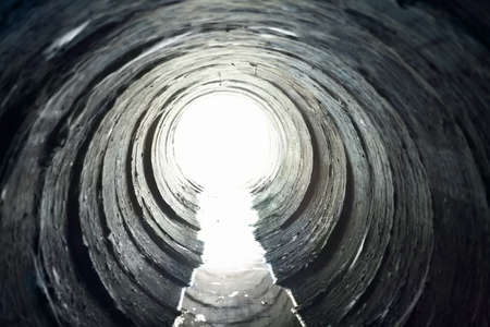 sewer: Light at End of Round Tunnel Stock Photo