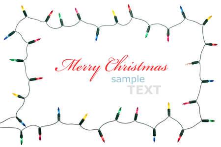christmas lights: Natale luci telaio isolato su sfondo bianco con spazio di copia. Ghirlanda decorativo