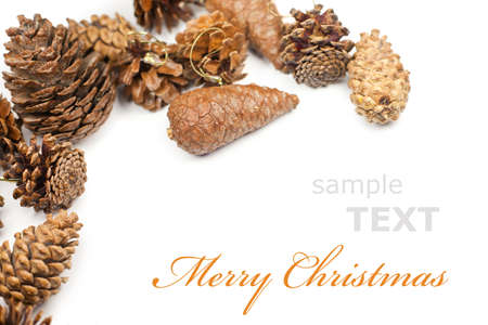 festive pine cones: Christmas cones frame isolated on white background with copy space for text  Stock Photo