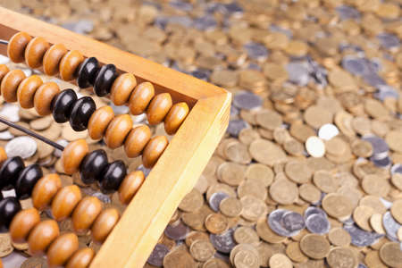 arithmetic: Accounting abacus and heap of coins  Stock Photo