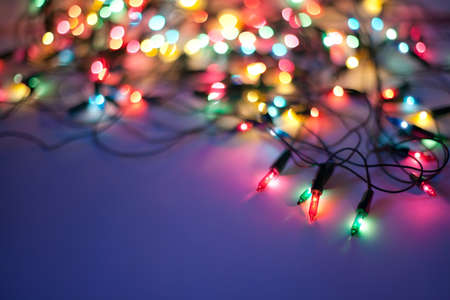 Christmas lights on dark blue background with copy space. Decorative garland Stock Photo - 10332129