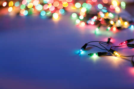 Christmas lights on dark blue background with copy space. Decorative garland Stock Photo - 10332106