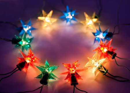 Christmas lights in ring on dark background with copy space.Decorative garland  Stock Photo - 10332167