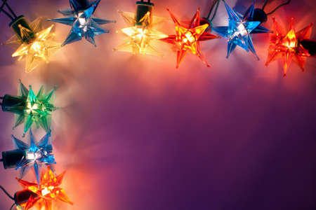 Christmas lights frame on dark background with copy space.Decorative garland