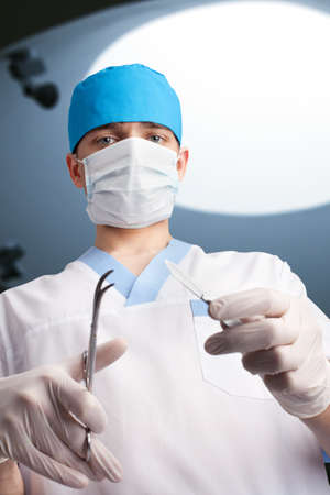 Surgeon working in operating room. Looking at camera. Bottom view  Stock Photo