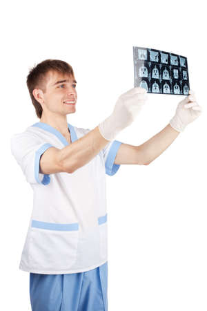 computer tomography: smiling medical doctor looking at CT computer tomography scan image isolated on white background