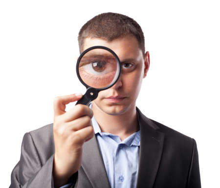 Businessman looking through a magnifying glass isolated on white background  photo