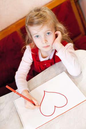 soft tip pen: little girl draws heart. Valentine Stock Photo