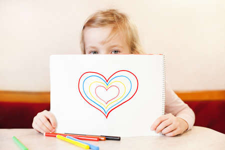 soft tip pen: little girl holding album with hearts. Valentine