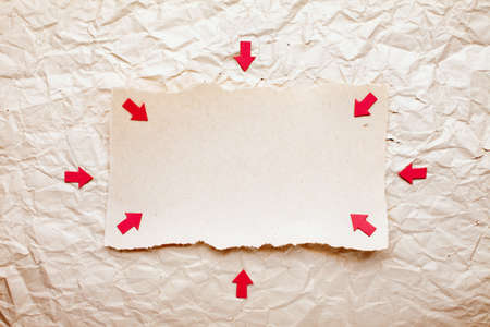 ripped piece of paper with red arrows on old crushed paper background. vintage retro card Stock Photo - 10332313