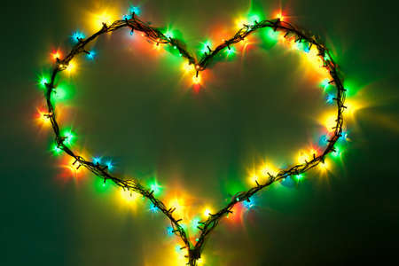 shining heart on dark green background. Valentine photo