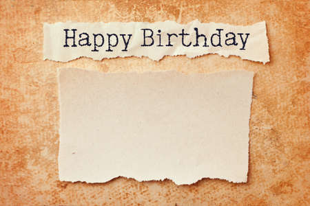 birthday banner: Paper with ripped edges on grunge paper background. Happy birthday Stock Photo