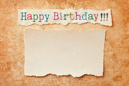 post cards: Paper with ripped edges on grunge paper background  Happy birthday card Stock Photo