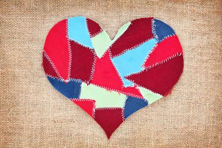fabric scraps heart on texture grunge background  Valentine photo