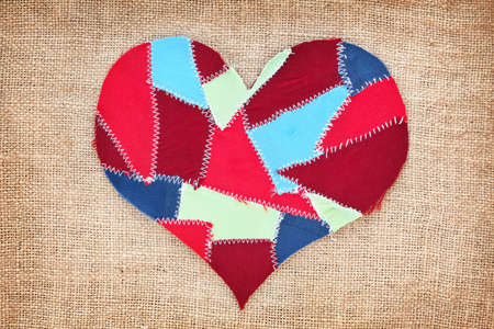 fabric scraps heart on texture grunge background  Valentine Stock Photo - 18382779
