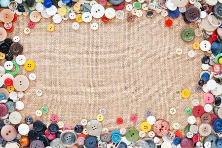 sew: Knoppen frame op stof textuur achtergrond Stockfoto