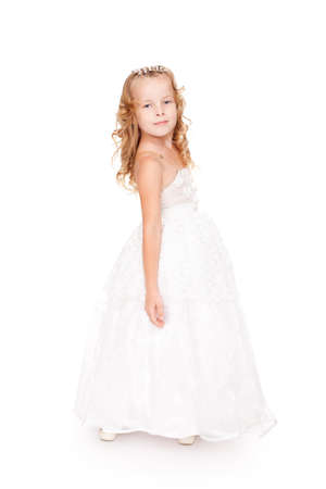 queen of angels: pretty little girl in beautiful white dress isolated on white background