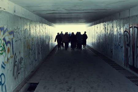 People in Subway. Light at End of Tunnel photo